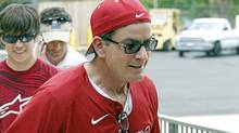 Charlie Sheen helps carry coolers full of food for a benefit baseball game and concert in Tuscaloosa, Ala., for victims of the tornadoes that swept through the area on April 27. (Butch Dill/AP)