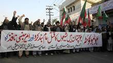 "Supporters of the Imamia Students Organisation (ISO) and the Majlis-e-Wahdat-e-Muslimeen (MWM) religious group attend a protest against the bomb blasts in Quetta a day earlier, in Lahore January 11, 2013. The banner reads, ""Bloody Quetta. Stop the mass murder of Shiites in Baluchistan and impose a state of emergency."" (MANI RANA/REUTERS)"
