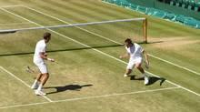 American Jack Sock and Vasek Pospisil celebrate after their Wimbledon semi-final win (@Wimbledon Twitter)