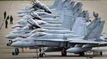 CF-18s at CFB Cold Lake, Alta., are lined up on the tarmac before take off on Sept. 18, 2010. (JOHN LEHMANN/JOHN LEHMANN/THE GLOBE AND MAIL)