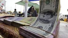 Banknotes are displayed on a roadside currency exchange stall along a street in Juba, South Sudan. (Thomas Mukoya/Reuters/Thomas Mukoya/Reuters)