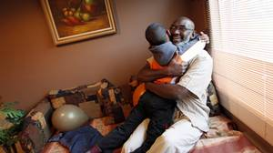 Abusoufian Abdelrazik embraces his 6-year-old son, Kouteyba, at his Montreal home on Sept. 22, 2009.
