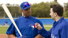 Toronto Blue Jays Yunel Escobar chats with GM Alex Anthopoulos at Jays Spring Training in Dunedin, Fla. on Saturday February 25, 2012. (Frank Gunn/THE CANADIAN PRESS)