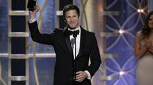 Andy Samberg holds his award for Best Actor in a TV Series, Musical or Comedy, for Brooklyn Nine-Nine during the 71st annual Golden Globe Awards in Beverly Hills. (PAUL DRINKWATER/REUTERS)