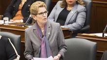 Ontario Premier Kathleen Wynne speaks in question period at Queen's Park in Toronto on Feb. 22. (Nathan Denette/THE CANADIAN PRESS)
