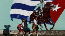 Cuban students walk in front of a mural of the Cuban flag in Havana, Cuba, November 22, 2016. REUTERS/Enrique de la Osa (ENRIQUE DE LA OSA/REUTERS)