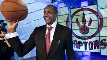 Toronto Raptors new president and general manager Masai Ujiri poses for photographers during a press conference in Toronto on Tuesday, June 4, 2013. (Nathan Denette/THE CANADIAN PRESS)