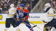 Edmonton Oilers forward Connor McDavid (97) and Buffalo Sabres defensemen Josh Gorges (4) battle in front of the Buffalo Sabres net during the third period at Rogers Place in Edmonton, Alberta on Sunday, Oct. 16, 2016. (Perry Nelson/USA Today Sports)