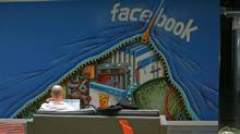 An employee works on a computer at the new headquarters of Facebook in Menlo Park, Calif. in this Jan. 11, 2012 file photo. (Robert Galbraith/Reuters/Robert Galbraith/Reuters)