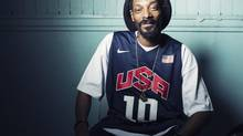 """Snoop Lion at Miss Lily's in New York on July 30, 2012. The artist formerly known as Snoop Dogg says he was """"born again"""" during a visit to Jamaica in February, changed his name to Snoop Lion and is ready to make music that his """"kids and grandparents can listen to."""" (Victoria Will/AP)"""
