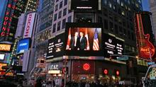A shot of Liberal Leader Michael Ignatieff with U.S. President Obama graces a giant screen in Times Square in February of 2009. (PR Newswire)