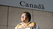 Chief David Harper poses outside of a federal government building in Winnipeg on Sept. 16, 2009, after returning body bags that were delivered to his northern Manitba reserve. (David Lipnowski/The Canadian Press)