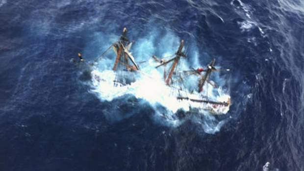 An HMS Bounty replica is shown submerged in the Atlantic Ocean during Hurricane Sandy approximately 145 kilometres southeast of Hatteras, North Carolina in this U.S. Coast Guard handout picture taken October 29, 2012. Of the 16-person crew, the Coast Guard rescued 14, recovered a woman and is searching for the captain of the vessel. (Petty Officer 2nd Class Tim Kuklewski/USCG/REUTERS)