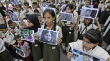 Pakistani students hold pictures of 14-year-old schoolgirl Malala Yousafzai, who was shot last Tuesday by the Taliban for speaking out in support of education for women, during a protest condemning the attack, in Karachi, Pakistan. (Fareed Khan/AP)