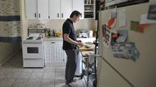 Jonathan Coe makes sushi in his Parkdale apartment on Queen West in Toronto, July 8, 2013. Mr. Coe is unable to buy a condo due to last year's mortgage changes made by Finance Minister Jim Flaherty. (J.P. MOCZULSKI for The Globe and Mail)