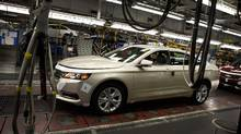 Impala models on the line at the General Motors Oshawa assembly plant Aug 28, 2013. (Moe Doiron/The Globe and Mail)