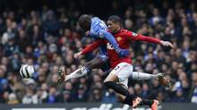 Chelsea's Demba Ba (L) challenges Manchester United's Chris Smalling during their English FA Cup quarter-final replay soccer match at Stamford Bridge in London April 1, 2013. (STEFAN WERMUTH/Reuters)