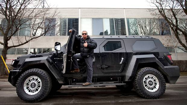 Globe and Mail columnist Peter Cheney stands on the running board of the Conquest Knight, billed as the world's largest, most secure SUV. Buyers include Russian oligarchs, an Arab Emirates oil potentate and a U.S. billionaire whose wife uses the Knight to take their children to school. (Moe Doiron/The Globe and Mail)
