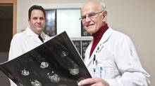 Dr. Paul Echlin and Dr. Charles Tator, both experts in concussions, are seen with MRI brain scans at Toronto Western Hospital on February 6, 2011. (JENNIFER ROBERTS For The Globe and Mail)