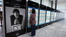 A visitor looks at Apple patents displayed at the World Intellectual Property Organization headquarters in Geneva, March 29, 2012. (DENIS BALIBOUSE/Denis Balibouse/Reuters)