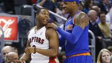 New York Knicks Carmelo Anthony (R) jokes with Toronto Raptors Kyle Lowry during the first half of their NBA basketball game in Toronto March 22