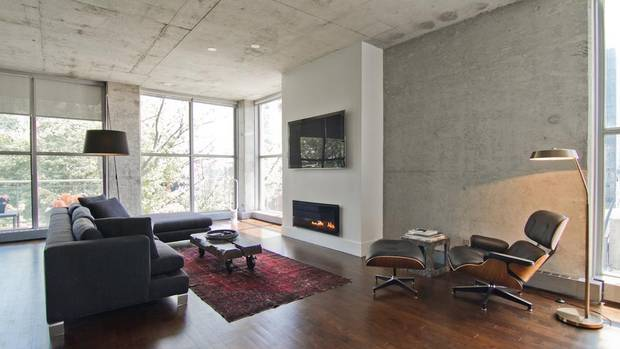The building was constructed in the mid-1990s and was a true conversion-style loft with exposed concrete, open spaces and floor-to-ceiling windows. The current owner of this home bought it in 2010, attracted by the spaciousness of the two-bed, two-bath layout and the sense of privacy despite being in the heart of a trendy community.