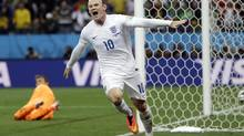 England's Wayne Rooney celebrates after scoring (Kirsty Wigglesworth/AP)