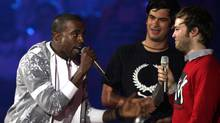 "Kanye West, left, complains alongside Jeremie Rozan and Martial Schmeltz, directors of the video for ""We Are Your Friends"" by Justice Vs Simian at the MTV Europe Music Awards in Copenhagen (JON SUPER)"