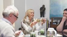 Christiane Germain chooses between local artists at Winnipeg's Gurevich Fine Art (Carey Shaw/Carey Shaw)
