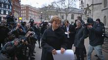 Marina Litvinenko speaks to reporters outside The High Court after receiving the results of the inquiry into the death of her husband Alexander Litvinenko, on January 21, 2016 in London. (Dan Kitwood/Getty Images)