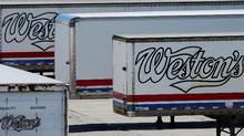 Weston Bakery truck trailers sit idle at a George Weston Ltd. owned facility on the Queensway in Toronto. (Louie Palu/The Globe and Mail)