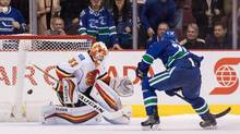 Brandon Sutter #20 of the Vancouver Canucks scores the game winning goal against goaltender Chad Johnson #31 of Calgary Flames during a shootout of their NHL game at Rogers Arena on October 15, 2016 in Vancouver, British Columbia, Canada. (Ben Nelms/Getty Images)