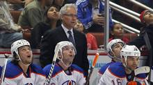 Edmonton Oilers' head coach Tom Renney (back C) stands behind the bench uring their NHL game in Anaheim, California March 5, 2012. (Mike Blake/Reuters/Mike Blake/Reuters)