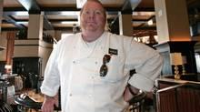 Celebrity chef Mario Batali poses in his latest restaurant, Del Posto, in New York April 11, 2006. (BRENDAN MCDERMID/File Photo | Brendan McDermid / Reuters)