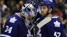 Toronto Maple Leafs goalie James Reimer is consoled by teammate Darryl Boyce (R) after losing to the Washington Capitals during overtime in their NHL hockey game in Toronto April 5, 2011. (MIKE CASSESE)