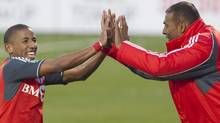 Toronto FC 's Joao Plata, left, celebrates after scoring from the penalty spot with head coach Aron Winter during second half MLS action against Houston Dynamo in Toronto on Saturday May 7, 2011. THE CANADIAN PRESS/Chris Young (Chris Young/CP)