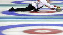 Canada's Kevin Koe aims the stone during a match against Sweden at the World Men's Curling Championship at the Capital Gymnasium in Beijing Wednesday, April 2, 2014. (Alexander F. Yuan/AP)