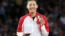 Canada's Michelle Li poses with her gold medal after her victory over Scotland's Kirsty Gilmour at the end of their women's single's Badminton match at the Emirates Arena during the Commonwealth Games Glasgow 2014, in Glasgow, Scotland, Sunday, Aug. 3. (Scott Heppell/AP)
