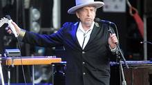 "This July 22, 2012 file photo shows U.S. singer-songwriter Bob Dylan performing on at ""Les Vieilles Charrues"" Festival in Carhaix, western France. A staff writer for The New Yorker has resigned and his latest book has been halted after he acknowledged inventing quotes by Bob Dylan. (David Vincent/AP)"