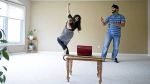 Pamela and Amar Bhavra practice a Bhangra dance, for an upcoming friend's wedding, in their new home in Edmonton, Alberta on August 4, 2010.