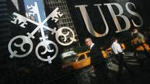 A UBS office building in New York. UBS AG is charging fees on some Swiss franc deposits by rival banks. (Mark Lennihan/AP)