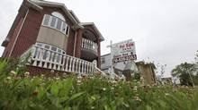 "A ""for sale"" sign is seen outside a home in New York June 19, 2012. (SHANNON STAPLETON/REUTERS)"