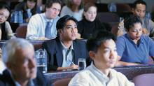 Businesspeople at conference (Comstock/Getty Images/Comstock Images)