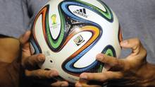 "The official match ball for the 2014 World Cup named ""Brazuca"" is presented in Rio de Janeiro in this December 3, 2013 file photo. (STRINGER/BRAZIL/REUTERS)"