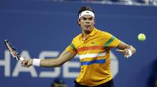 Milos Raonic, of Canada, returns a shot to Andy Murray, of Britain, during a match at the U.S. Open tennis tournament, Monday, Sept. 3, 2012, in New York. (Darron Cummings/AP)