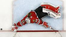 Chicago Blackhawks goalie Corey Crawford makes a save in overtime against the Boston Bruins during Game 1 of their NHL Stanley Cup Finals hockey series in Chicago, Illinois, June 12, 2013. (Reuters)