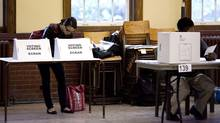 A woman casts her ballot at a voting station in Toronto as voters participate in the Ontario provincial election on Thursday October 6, 2011. (Chris Young/THE CANADIAN PRESS)