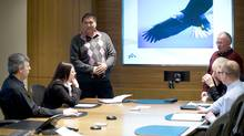 Consultant Tom Erasmus, standing left, leads an aboriginal awareness training session at Newalta Corp. in Calgary. (Jacqueline Bean/Copyright ©2011 Newalta Corporation. All rights reserved)
