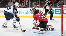 Winnipeg Jets right wing Patrik Laine skates with the puck on his way to scoring the game winning goal during the shootout against New Jersey Devils goaltender Cory Schneider at the Prudential Center in Newark, New Jersey, on March 28, 2017. (Christopher Pasatieri/Getty Images)