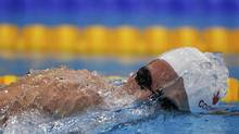 Canada's Ryan Cochrane swims to a first place finish in heat 3 of the men's 1500-metre freestyle event during the London 2012 Olympic Games at the Aquatics Centre on Friday. (JORGE SILVA/REUTERS)
